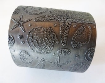 Wide Pewter Sealife Cuff - a wider, natural pewter sealife cuff, flexible and adjustable for easy wear!