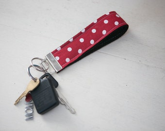 red with white dots on black key chain. Key chain Fob. key chain wristlet