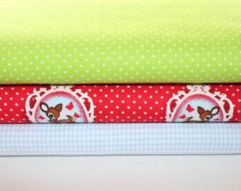 Fabric deer red green polka dot 1,5 meter