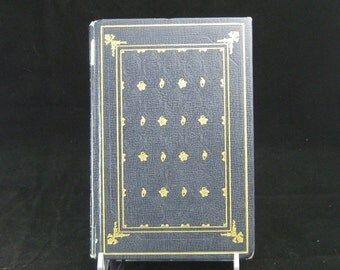 Vintage 1931 edition of Mark Twain's The Adventures of Huckleberry Finn International Collectors Library HB