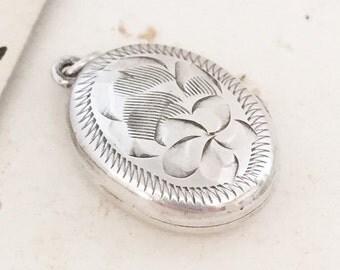 Pretty little silver vintage locket