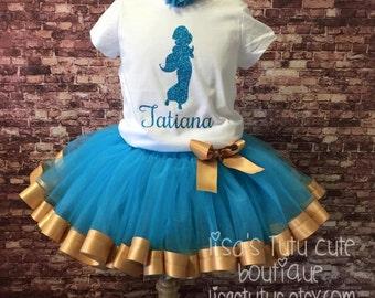 Princess birthday tutu. Jasmine tutu. Jasmine birthday outfit. Ribbon trimmed tutu. Blue and gold tutu. Princess silhouette.