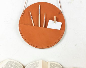 Leather wall pocket.