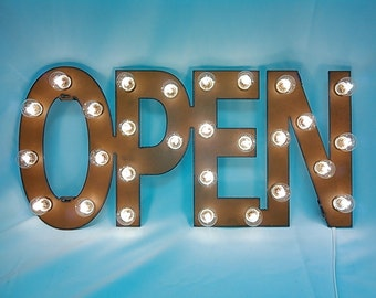Open Marquee Lighted sign made out of rusted metal