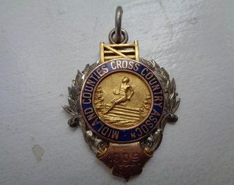 Sterling, 9 c Gold, Enamel Cross Country Medal