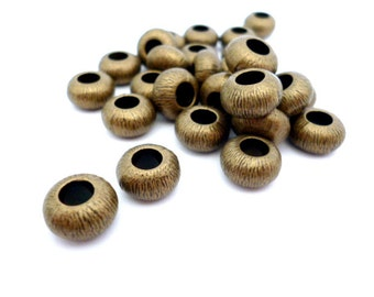 Brass Large Hole Beads_RB20114523NAC/003_Metal Beads_Bronze 11x6mm hole 4mm pack 18 pcs_