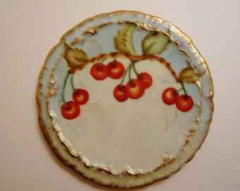 Tea Tile Trivet Hand Painted Porcelain Numbered - Gold Edged and Decorated with Cherries on the Vine.