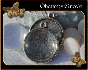 2 smooth silver settings with 20mm cabochons