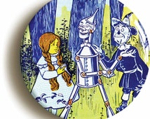 Dorothy, Tin Man and Scarecrow Wonderful Wizard of Oz badge pin button (size is 1inch/25mm diameter)