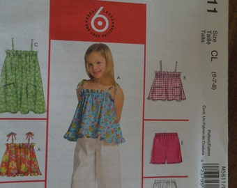 McCalls M5611, sizes 6-8, girls, childrens, tops, dress, skirt, shorts and pants, UNCUT sewing pattern, craft supplies