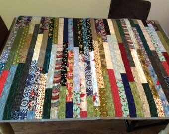New, original, jelly roll scrappy quilt.  Lap quilt.  Perfect for any couch!