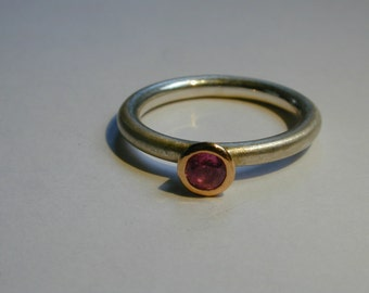 Sterling Silver ring with pink Sapphire set in Rose gold