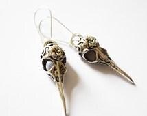 On Trend Antique Silver Tone Bird Skull Design Drop Earrings