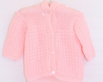 Vintage baby sweater, pink knit with 4 pearly buttons up the front and a hood with a snowball at top, Mon Petit sz Newborn