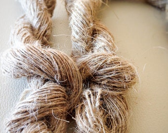 Linen yarn, hand spun, single, in skein from 100 gr. Grown and spun by hand in Italy.