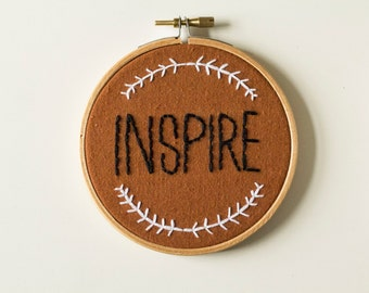 Handmade embroidery in hoop with quote 'Inspire'