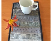Quilted mug rug. Office decor. Mini quilt. 8x12.5 inches. Small wall art. For the studio. Grey table topper. Gift for quilter. Fabric art.