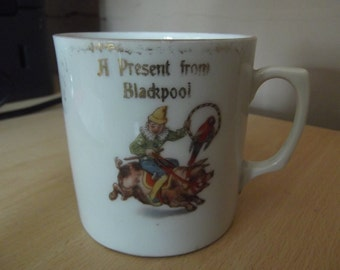 Antique child's nursery mug - A present from Blackpool, clown on pig