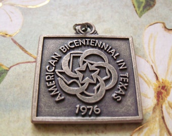 vintage 1976 faternity pendant pewter