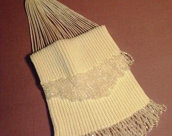 New lower price on 1920s flapper beaded bag in white crochet with clear beaded trim.  Excellent condition.