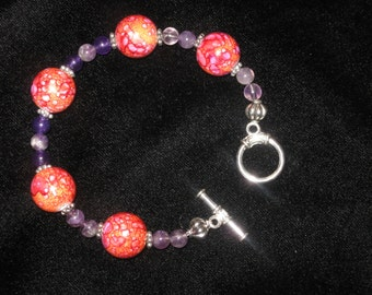 Orange and magenta abstract beads with amethyst and silver bead bracelet