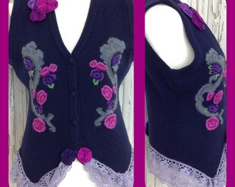 Ladies unique refashioned knitted waistcoat. Upcycled / suffolk puffs / yoyos / lace / navy / pinks