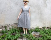 V neck cotton dress with gathered skirt, side pockets, fabric belt