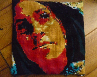 Embroidered cushion with a portrait of singer Alanis Morisette