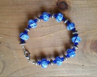 Blue lampwork bead bracelet.