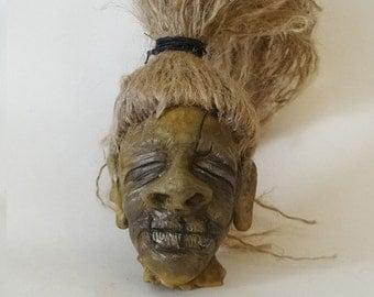 Shrunken head sculpture tiki kustom kulture