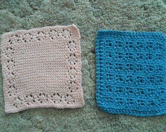 Two knitted dishcloths or washcloths.