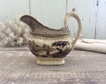 Antique English brown transferware creamer