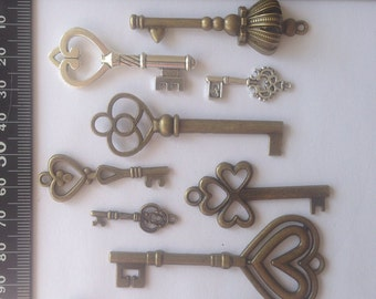 Mixed Bag of 10 Key Charms and Pendants, assorted designs. Different sizes