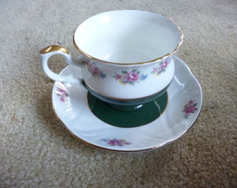 Cup and saucer, fine bone china rimmed in gold: Crown - Staffordshire, England.