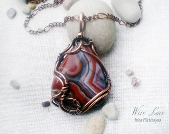 Copper pendant with crazy lace agate. Wire jewelry. Gemstone.