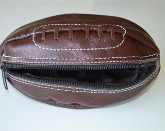 A vintage style leather rugby ball wash bag