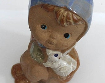 Pottery Doll hold rabbit