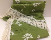 "Green round tablecloth with white daisies and white fringe border 60"" diameter"