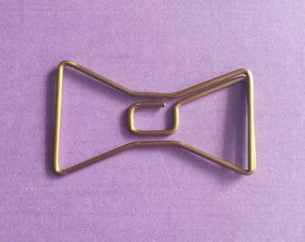 Gold bow paperclip