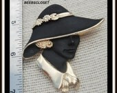 Vintage broach woman's face wearing a beautiful hat with flowers and a lovely gold color what wonderful detail on this brooch