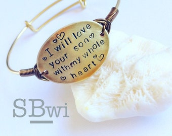 Adjustable, hand stamped bracelet in brass with copper, wire wrapped detail
