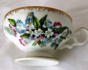 Vintage UCAGCO FOOTED TEACUP Floral Porclain Ceramic Gold Leaf Accents