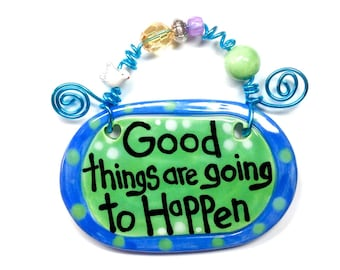 Good things are going to happen green ceramic sign