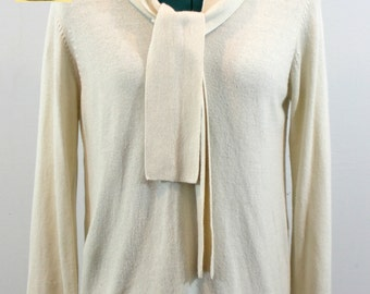 Cream silk angora blend sweater with with front tie and long sleeves. By Preston and York