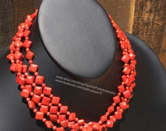 Three strands of Apple Coral with Sterling Silver.