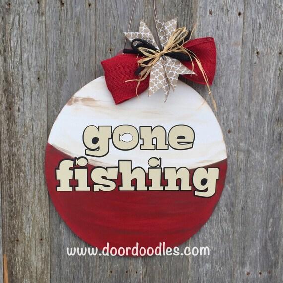 Items similar to Gone fishing bobber front door hanger ...