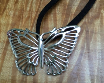 Sterling silver butterfly on a suede cord