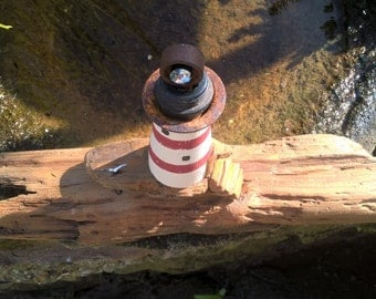 Lighthouse on driftwood
