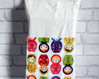 Russian nesting doll Matryoshka (Little Kukla) shopping tote. Double lined polycotton bag in natural white colour. Front pocket for notebook