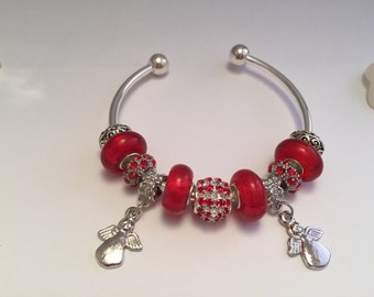 Red charm's rigid bracelet with charms Angels ref 570